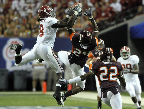 090905 Atlanta - Alabama WR Julio Jones (left, #8) and Virgina Tech ROV Dorian Porch (center, #24) hang in the air as Jones fails to catch the ball in the first half action Saturday night at Georgia Dome. Alabama comes into the Chick fil A game against Virginia Tech in a much better position than a year ago. Alabama returns as a Top 10 team to face ACC power Virginia Tech. Saturday, September 5, 2009. Hyosub Shin, hshin@ajc.com